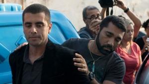 "Brazilian ""celebrity"" surgeon Dr. Denis Cesar Barros Furtado is escorted by police after his arrest in Rio de Janeiro, Brazil, Thursday, July 19, 2018.  (AP Photo/Leo Correa)"