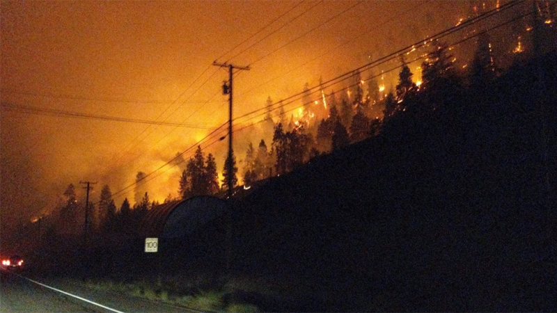 The Mount Eneas wildfire burns alarmingly close to Highway 97 on Wednesday, July 18. (Twitter: Jenna Elyse)