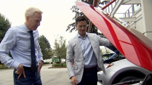 Toyota Pacific Zone manager David Lee shows Ross McLaughlin under the hood of one of their hybrid vehicles. (CTV)