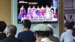 A TV screen shows a blurred photo of North Korean restaurant workers in China, during a news program at the Seoul Railway Station in Seoul, South Korea on Friday, July 20, 2018. (AP Photo/Ahn Young-joon)