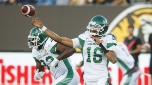 Saskatchewan Roughriders quarterback Brandon Bridge throws the ball during first half CFL football action against the Hamilton Tiger-Cats, in Hamilton, Ont. on Thursday July 19, 2018. THE CANADIAN PRESS/Mark Blinch