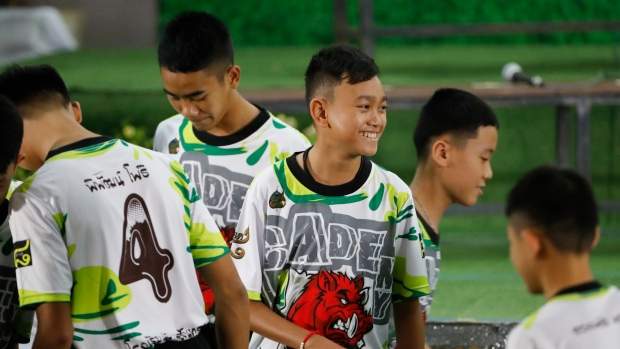 Members of the rescued soccer team attend a press conference discussing their experience of being trapped in the cave in Chiang Rai, northern Thailand, Wednesday, July 18, 2018. (AP Photo/Vincent Thian)
