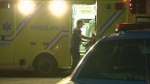 A paramedic loads an ambulance following a shooting in LaSalle that left a 42-year-old man with severe leg injuries