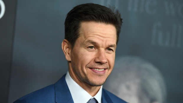 "In this Dec. 18, 2017 file photo, Mark Wahlberg arrives at the world premiere of ""All the Money in the World"" at the Samuel Goldwyn Theater in Beverly Hills, Calif. The 47-year-old actor, producer, businessman and former rapper on Thursday, July 19, 2018, announced he's launching his first car dealership. (Photo by Jordan Strauss/Invision/AP, File)"