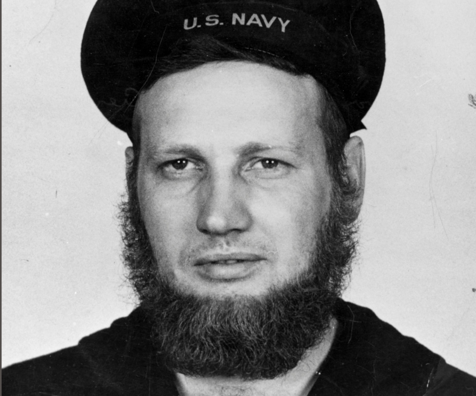 In this June 20, 1942 photo provided by the Naval History and Heritage Command, Howard Curtis, a U.S. Navy second-class aerographer, wears a seven-month's beard at Dutch Harbor, Alaska. (Naval History and Heritage Command via AP)