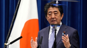 Japanese Prime Minister Shinzo Abe delivers a speech during a press conference at the prime minister's official residence in Tokyo Friday, July 20, 2018. (AP Photo/Eugene Hoshiko)