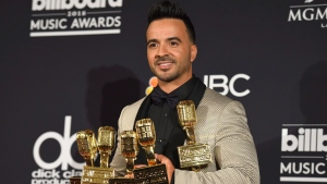 "Luis Fonsi, singer of ""Despacito"", poses in the press room at the Billboard Music Awards at the MGM Grand Garden Arena on Sunday, May 20, 2018, in Las Vegas. (Photo by Jordan Strauss/Invision/AP)"