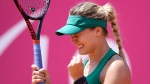 Eugenie Bouchard of Canada, celebrates after winning the game against Viktorija Golubic of Switzerland during the round of 16 game at the WTA Ladies Championship tennis tournament in Gstaad, Switzerland, Thursday, July 19, 2018. (Anthony Anex/Keystone via AP)