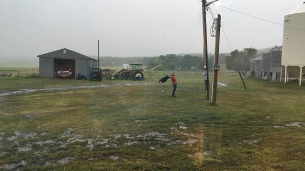 A grateful farmer enjoying the much needed rain! Photo by: Cheryl Yake