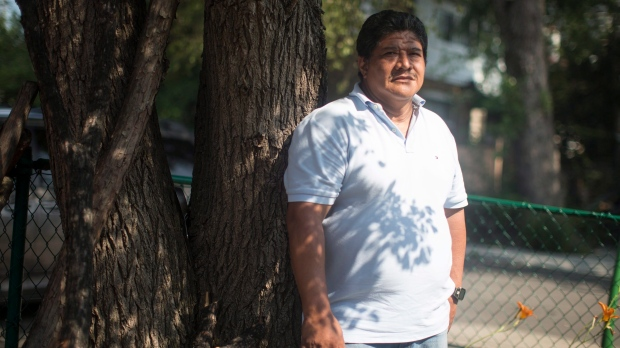 Carlos Zuniga, 52, a doctor who fled El Salvador with his wife and two sons, is pictured at the FCJ Refugee Centre in Toronto on Tuesday July 10, 2018. THE CANADIAN PRESS/Chris Young