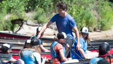 Prime Minister Justin Trudeau greets campers while visiting Tim Horton Memorial Camp in McDougall, Ont. on Thursday, July 19, 2018. THE CANADIAN PRESS/Frank Gunn
