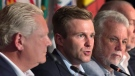 New Brunswick Premier Brian Gallant, flanked by Ontario Premier Doug Ford, left, and Quebec Premier Philippe Couillard, fields a question at the closing news conference of the Canadian premiers meeting in St. Andrews, N.B. on Friday, July 20, 2018. (Andrew Vaughan / THE CANADIAN PRESS)