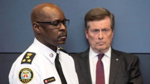 Toronto police chief Mark Saunders and Toronto mayor John Tory are seen at a news conference at TPS headquarters in Toronto on Tuesday, April 24, 2018.  (THE CANADIAN PRESS/Chris Young)