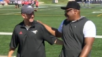 Dave Dickenson and Nik Lewis share a laugh at McMahon Stadium after Lewis retired as a Stampeder on July 20, 2018