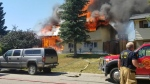 Fire crews at the scene of a July 20, 2018 fire on Knowles Avenue in Okotoks (image courtesy: The Eagle 100.9)