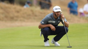 Dustin Johnson of the U.S. lines up a putt on the 3rd green during the first round of the British Open Golf Championship in Carnoustie, Scotland, Thursday July 19, 2018. (AP Photo/Jon Super)