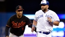 Toronto Blue Jays designated hitter Kendrys Morales (8) gets tagged by Baltimore Orioles second baseman Jonathan Schoop (6) after a late 3rd strike call led to confusion in the infield during sixth inning MLB baseball action in Toronto on Friday, July 20, 2018. THE CANADIAN PRESS/Frank Gunn