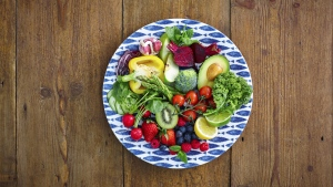 Filling up on healthy seasonal fruit and vegetables this summer is one way to avoid overindulging. (Dean Mitchell/Istock.com)