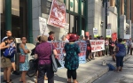 Approximately 30 people attended the demonstration outside the CBSA's downtown offices to demand a moratorium on deportations to Haiti. (Kelly Greig/CTV Montreal)