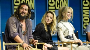 "Jason Momoa, from left, Amber Heard and Nicole Kidman attend the Warner Bros. Theatrical panel for ""Aquaman"" on day three of Comic-Con International on Saturday, July 21, 2018, in San Diego. (Photo by Chris Pizzello/Invision/AP)"