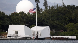 FILE - In this Dec. 27, 2016, file photo, USS Arizona Memorial, part of the World War II Valor in the Pacific National Monument, at Joint Base Pearl Harbor-Hickam, Hawaii. (AP Photo/Carolyn Kaster, File)