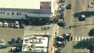 Several police officers surround a Trader Joe's in Las Angeles, Calif. on Saturday, July 21, 2018. (KCAL/ KCBS)