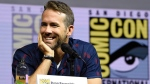 "Ryan Reynolds attends the ""Deadpool 2"" panel on day three of Comic-Con International on Saturday, July 21, 2018, in San Diego. (Photo by Chris Pizzello/Invision/AP)"