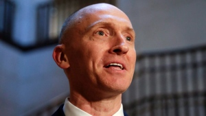 In this Nov. 2, 2017, file photo, Carter Page speaks with reporters following a day of questions from the House Intelligence Committee on Capitol Hill in Washington. (AP Photo/J. Scott Applewhite)