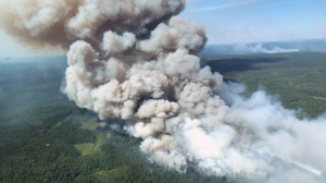 Smoke from a forest fire is seen from the air near Bissett Creek, Ont. Dozens of wildfires have been burning in the region, with many of them said to be out of control. (Ontario Ministry of Natural Resources and Forestry)