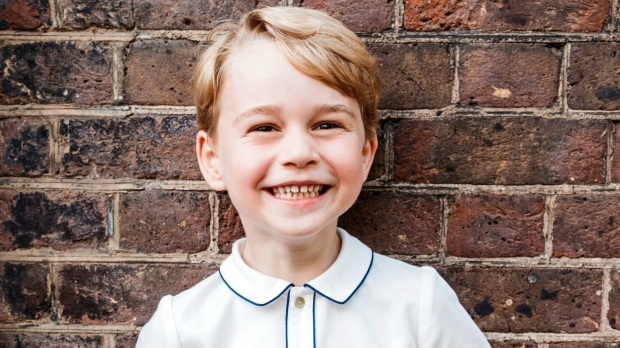 In this photo taken on Monday, July 9, 2018, Prince George poses for a picture following the christening of his brother Prince Louis, at Clarence House in London. Prince William and Kate, Duchess of Cambridge released the photo of Prince George to mark his fifth birthday on Sunday, July 22. (Matt Porteous / THE ASSOCIATED PRESS)