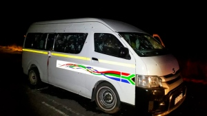 A minibus with bullet holes on its side is seen on the road between Weenen and Colenso, in KwaZulu Natal province, South Africa, early Sunday, July 22, 2018. South African police say gunmen opened fire on the vehicle carrying members of a taxi drivers' association, killing 11 people and critically wounding four others. (Claudine Senegal / THE ASSOCIATED PRESS)
