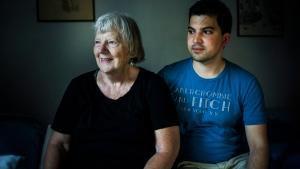 Elizabeth Hill poses for a portrait with her live-in student Julio Hernandez, in her home in Toronto, on Friday, July 20, 2018. (THE CANADIAN PRESS / Christopher Katsarov)