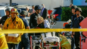 An armed standoff at a Trader Joe's in L.A. left one employee dead, and the wounded suspect was apprehended after several hours of tense negotiations.