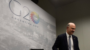 European Financial Affairs Commissioner Pierre Moscovici arrives to give a press conference during the G20 meeting of Finance Ministers and Central Bank governors in Buenos Aires, Argentina, Sunday, July 22, 2018. (AP Photo/Gustavo Garello)