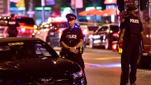 Police work at the scene of a mass casualty incident in Toronto on Sunday, July 22, 2018. (THE CANADIAN PRESS/Frank Gunn)