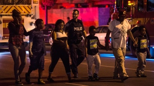 Police escort civilians away from the scene of a mass casualty incident in Toronto on Sunday, July 22, 2018. THE CANADIAN PRESS/Frank Gunn