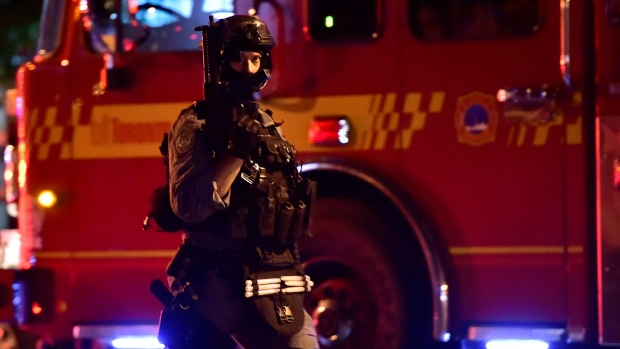 A tactical officer is seen at the scene of a mass casualty incident in Toronto on Sunday, July 22, 2018. THE CANADIAN PRESS/Frank Gunn