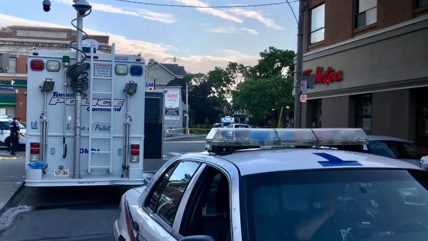 Two Police Command Post vehicles at the intersection of Danforth and Logan avenues in Toronto, Monday, July 23, 2018. (Cristina Tenaglia / CP24)