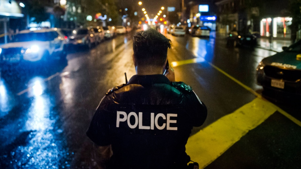 Police are seen around the scene of a shooting in east Toronto, on Monday, July 23, 2018. THE CANADIAN PRESS/Christopher Katsarov