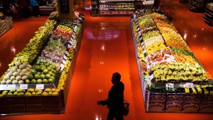 People shop in the produce area at a Loblaws store in Toronto on May 3, 2018. Some consumers have vowed to take their patriotism to the supermarket and buy only made-in-Canada products after the federal government slapped retaliatory tariffs on dozens of U.S. goods as part of an escalating trade war. THE CANADIAN PRESS/Nathan Denette