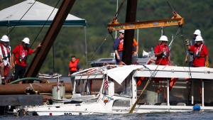 The duck boat that sank in Table Rock Lake in Branson, Mo., is raised Monday, July 23, 2018. (Nathan Papes/The Springfield News-Leader via AP)