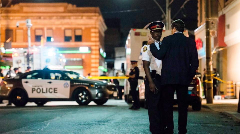 Toronto mayor John Tory and police chief Mark Saunders speak following a mass casualty event in Toronto on Monday, July 23, 2018. (THE CANADIAN PRESS/Christopher Katsarov)