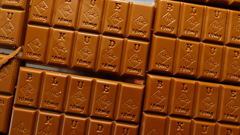 FILE -- In this Monday, Sept. 19, 2016, photograph, candy bars marked with Colorado's new required diamond-shaped stamp noting that the product contains marijuana are shown in the kitchen of BlueKudu candy in the historic Five Points District of Denver. (AP Photo/David Zalubowski)