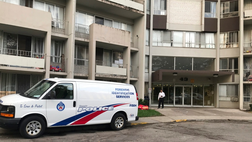 A Toronto Police forensic identification services van sits parked in front of an apartment building in Toronto's Thorncliffe Park, Monday, July 23, 2018. Shooting suspect Faisal Hussain lived in the complex. (THE CANADIAN PRESS / Tamara Lush)