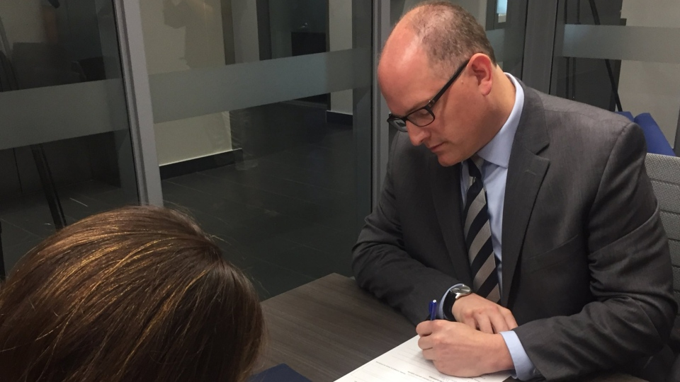 Drew Dilkens files his nomination papers seeking re-election in Windsor, Ont., on Tuesday, July 24, 2018. (Sacha Long / CTV Windsor)