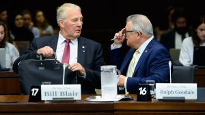 Public Safety and Emergency Preparedness Minister Ralph Goodale and Minister of Border Security and Organized Crime Reduction Bill Blair appear as witnesses at a House of Commons standing committee on immigration in Ottawa on Tuesday, July 24, 2018. THE CANADIAN PRESS/Sean Kilpatrick