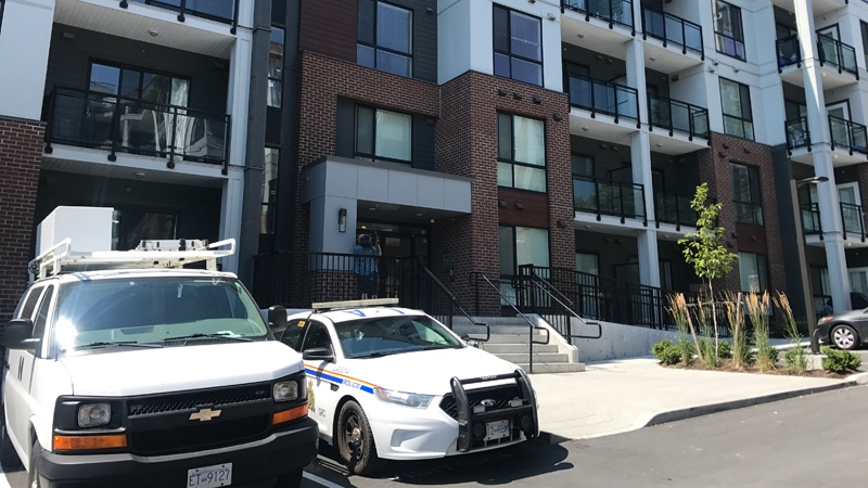 A police cruiser is parked in front of an apartment complex linked to a police investigation into the death of a seven-year-old in Langley, on Tuesday, July 24, 2018. (David Molko / CTV Vancouver)