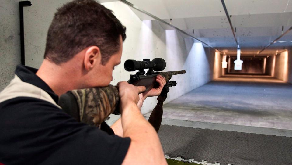 Patrick Deega aims a rifle at a shooting range in Calgary, Sept. 15, 2010. (THE CANADIAN PRESS/Jeff McIntosh)