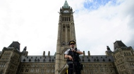 An RCMP officer stands watch on Parliament Hill, in Ottawa on Monday, July 23, 2018. THE CANADIAN PRESS/Sean Kilpatrick