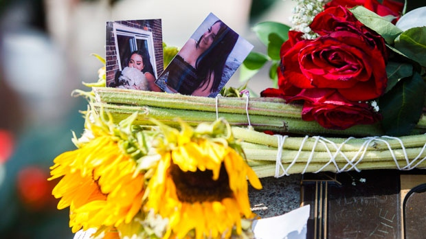 Photographs of Danforth shooting victim Reese Fallon, 18, are seen at a memorial remembering the victims of a shooting on Sunday evening on Danforth, Avenue in Toronto on Tuesday, July 24, 2018. (THE CANADIAN PRESS/Mark Blinch)
